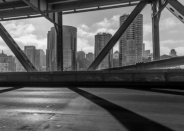 Modern Buildings Seen Through Bridge In City Photograph by Jesse Coleman / EyeEm