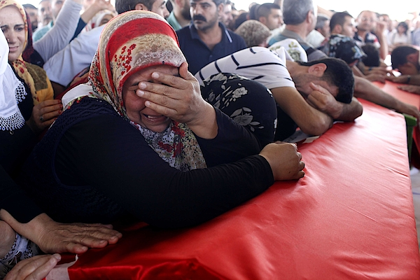 Mourners Attend The Funerals Of Those Killed In The Turkish Bomb Blast Photograph by Gokhan Sahin