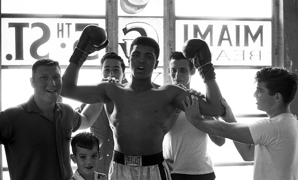 Marvin Newman Photograph - Muhammad Ali Raising Arms by Retro Images Archive