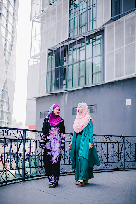 Muslim Women In Hijab In Discussion Photograph by Mikhaella Ismail