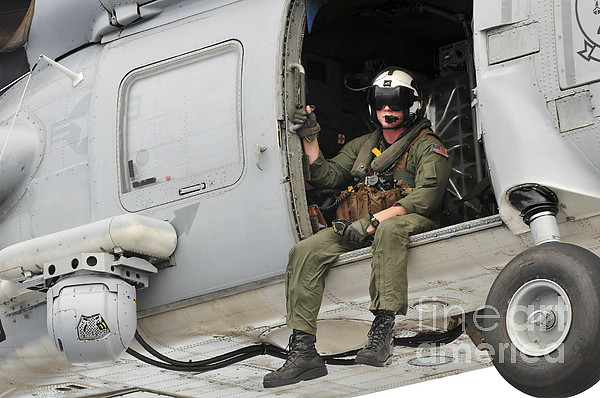 Military Photograph - Naval Aircrewman Acts In An Sh-60b Sea by Stocktrek Images