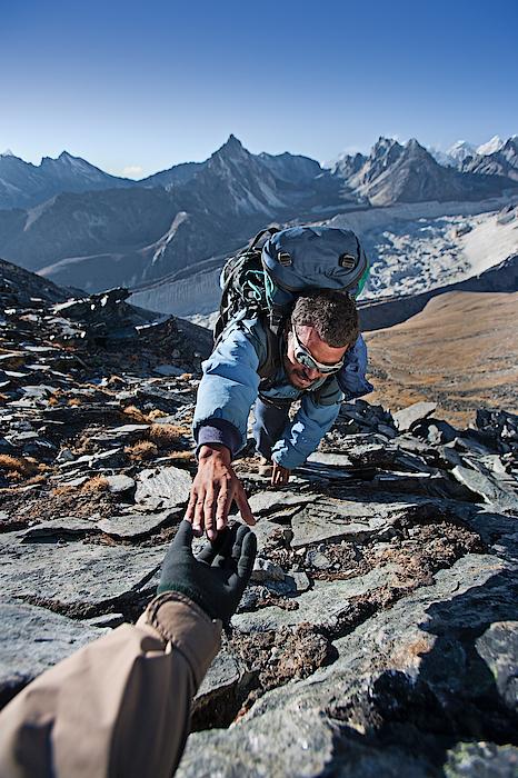 Nepali Sherpa Climbing In Himalayas Photograph by Hadynyah