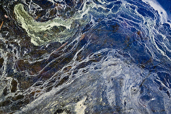 Abstract Photograph - Oil Spill Abstract by Dancasan Photography