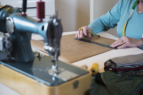 Old Woman Measuring With A Ruler On Sewing Desk Photograph by Dreet Production