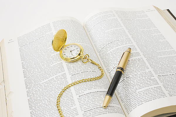 Open Book With Fountain Pen And Pocket Watch Photograph by GYRO PHOTOGRAPHY/amanaimagesRF