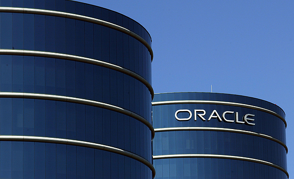 Oracle Makes Hostile Bid For Rival Peoplesoft Photograph by Justin Sullivan