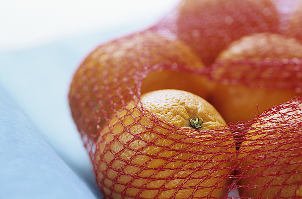 Oranges In Net, Close Up Photograph by Achim Sass
