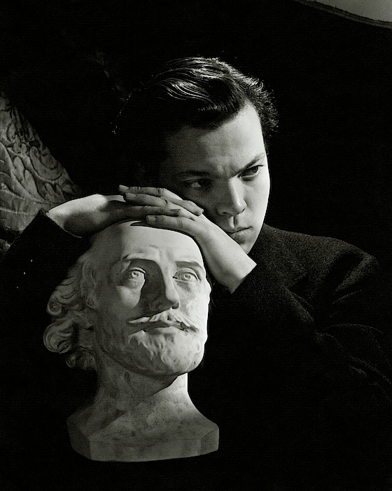 Orson Welles Resting On A Sculpture Photograph by Cecil Beaton