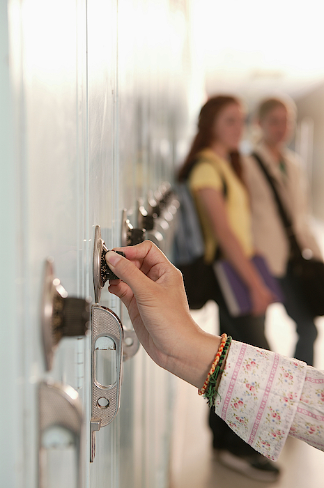 Person Unlocking School Locker Photograph by Comstock Images