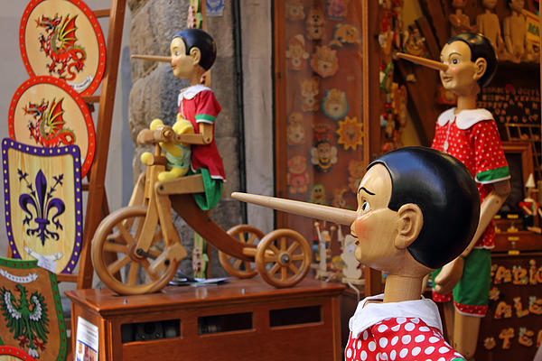 Marionette Photograph - Pinocchio Inviting Tourists In Souvenirs Shop by Kiril Stanchev