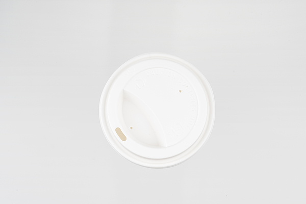 Plastic Lid Of Paper Cup Photograph by Copyright Xinzheng. All Rights Reserved.