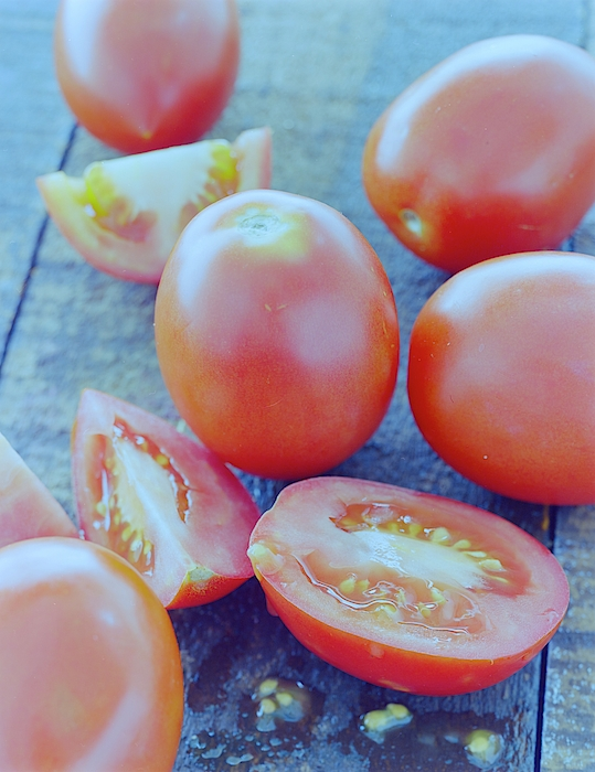 Plum Tomatoes On A Wooden Board Photograph by Romulo Yanes