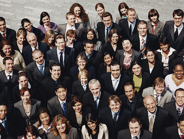 Portrait Of A Large Group Of Business People Standing Outdoors Photograph by Digital Vision.