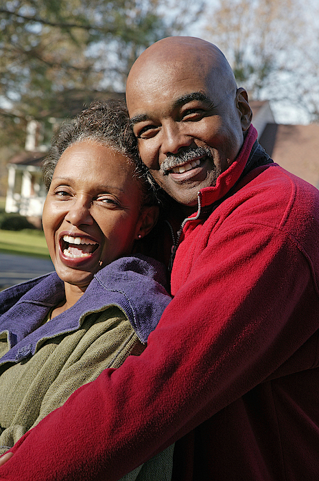 Portrait Of Couple Embracing Outdoors Photograph by Comstock