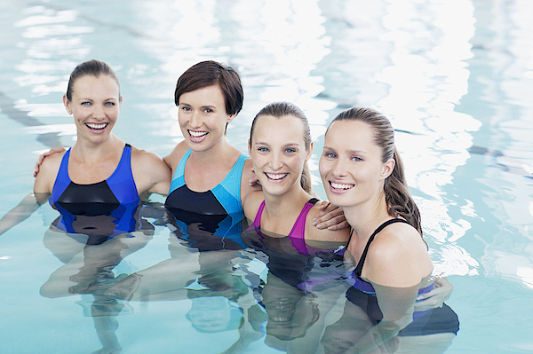 Portrait Of Smiling Women In Swimming Pool Photograph by Robert Daly