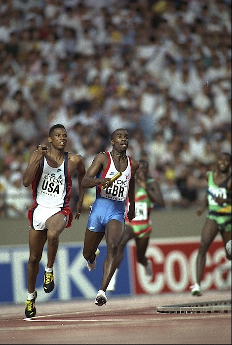 Quincy Watts Of The Usa And Derek Redmond Of Great Britain In Action In The 4 X 400 Metres Relay Photograph by Mike Powell
