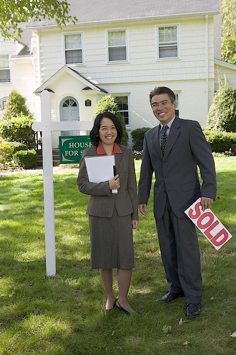 Realty Agents With Sold Sign Photograph by Comstock Images