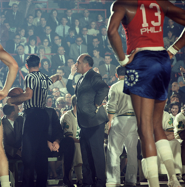 Marvin Newman Photograph - Red Auerbach Talks With Ref by Retro Images Archive