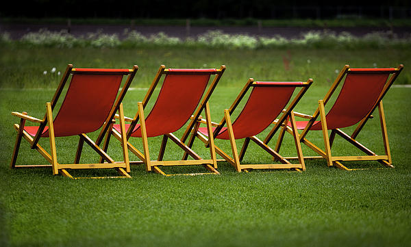 Lounge Photograph - Red Deck Chairs On The Green Lawn by Mikhail Pankov