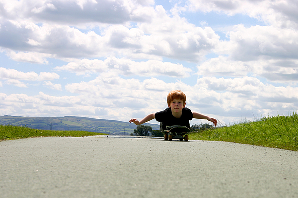 Red Headed Boy Skateboarding Photograph by Image by Catherine MacBride