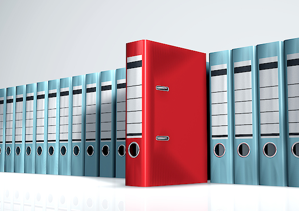 Red Lever Arch File In A Row Of Grey Files Photograph by Artpartner-images