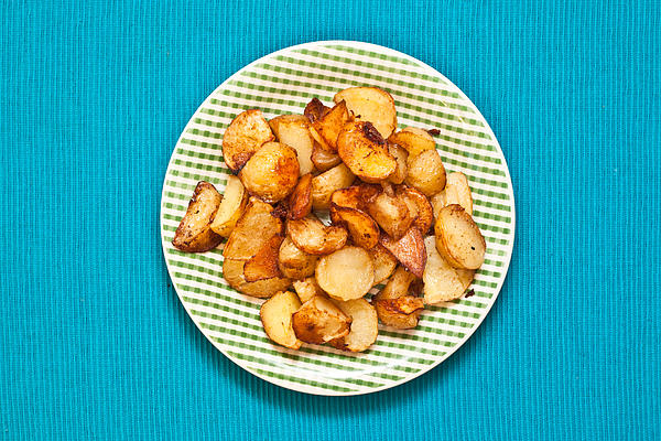Baked Photograph - Roast Potatoes by Tom Gowanlock