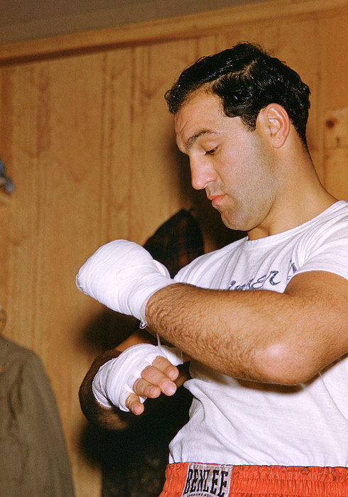 Marvin Newman Photograph - Rocky Marciano Getting Ready by Retro Images Archive
