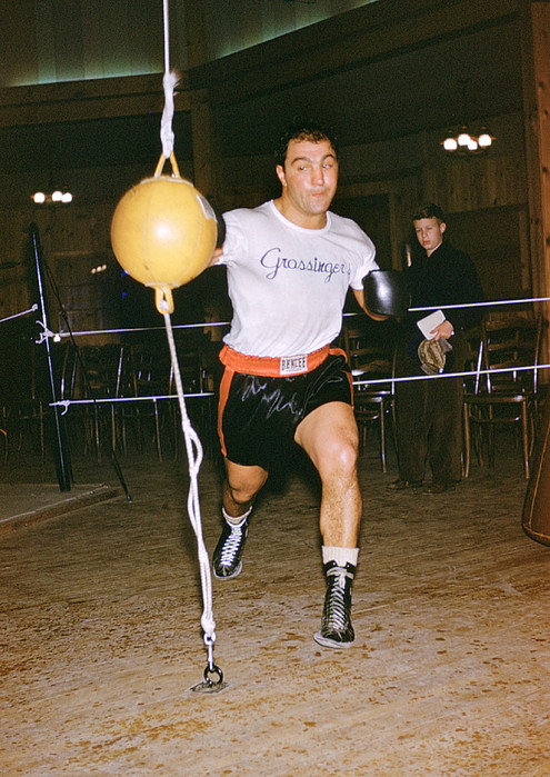 Marvin Newman Photograph - Rocky Marciano Striking Bag by Retro Images Archive