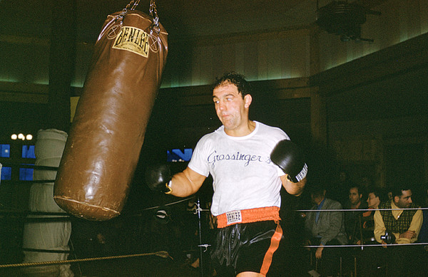 Marvin Newman Photograph - Rocky Marciano Working Heavy Bag by Retro Images Archive