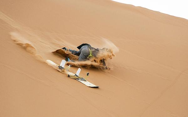 Sand-boarding The Saharan Sand Dunes, Merzouga, Morocco Photograph by Paul Biris