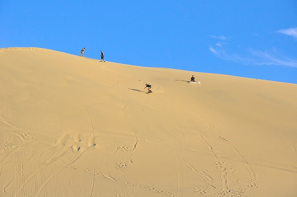 Sand Surfing In The Dunes Near Huacachina, Peru Photograph by Markus Daniel