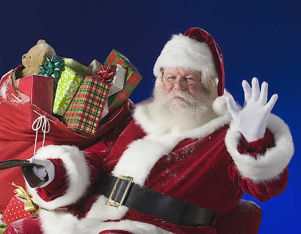 Santa Claus Next To Bag Of Toys Photograph by Tetra Images