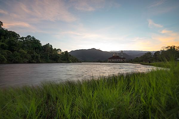 Scenic Shot Of Calm Lake Against Mountain Range Photograph by Shaifulzamri Masri / EyeEm