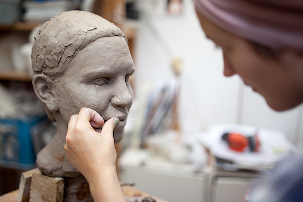 Sculptor Working On Head Sculpture Photograph by Guido Mieth