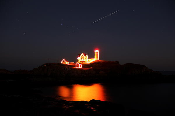 Nubble Lighthouse Photograph - Shooter by Andrea Galiffi