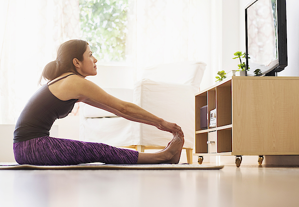 Side-view Of Woman Exercising In Living Room Photograph by Tetra Images
