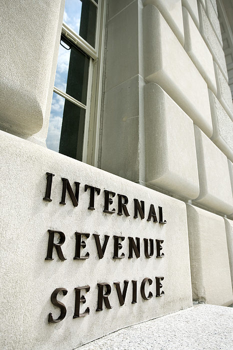 Sign On Internal Revenue Service Building, Washington, Dc Photograph by Thinkstock