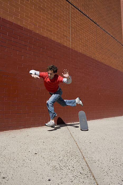 Skateboarder Falling Off  Board Photograph by Erin Patrice OBrien