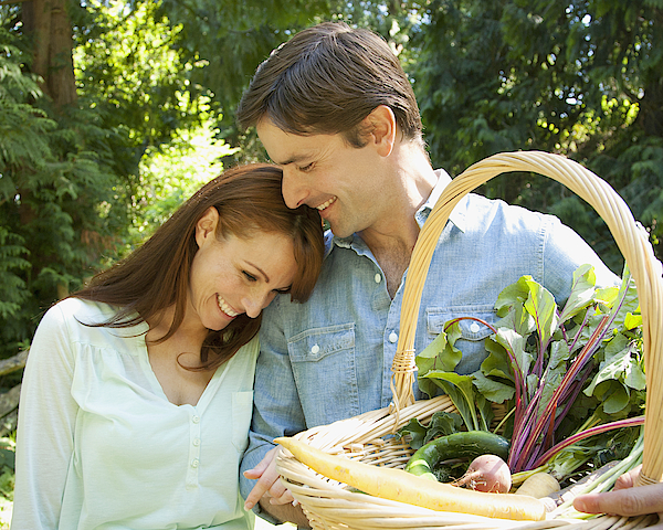 Smiling Couple With Basket Of Vegetables Photograph by Compassionate Eye Foundation