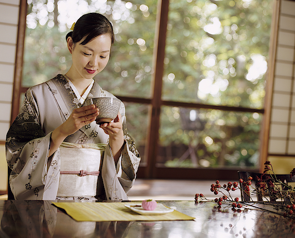 Smiling Woman Drinking Tea During A Japanese Tea Ceremony Photograph by Digital Vision.