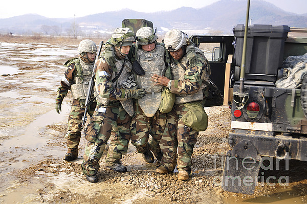 Army Photograph - Soldiers Conduct Medical Evacuation by Stocktrek Images