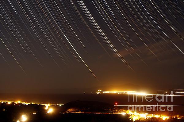 Horizontal Photograph - Star Trails Above A Village by Amin Jamshidi