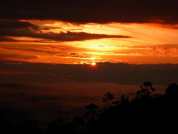 Sunrise Photograph - Sunrise Above The Clouds by Evan Hendrickson