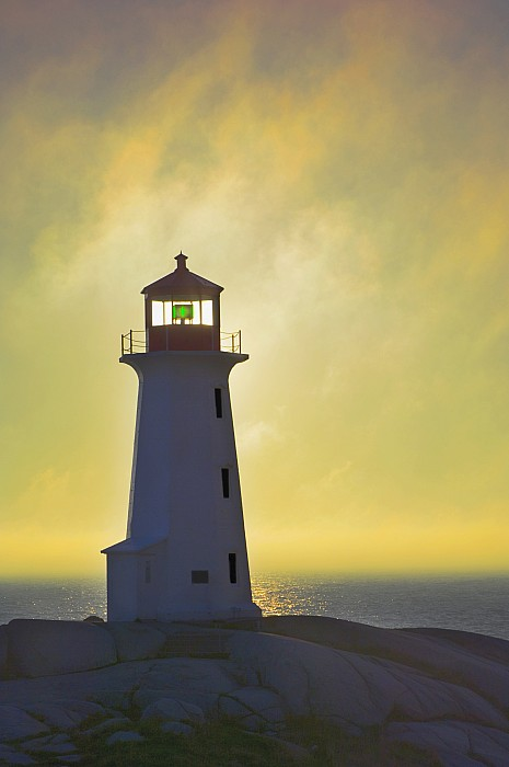 Beacons Photograph - Sunset Over Peggys Cove Lighthouse by Thomas Kitchin & Victoria Hurst