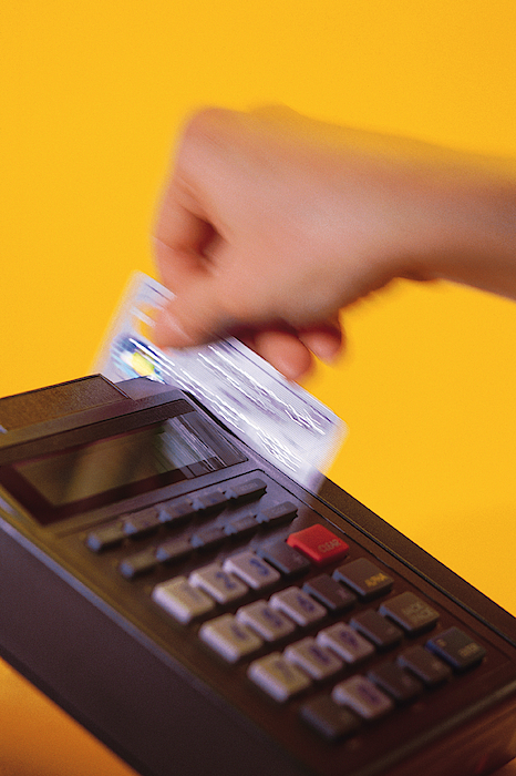 Swiping Credit Card Photograph by Comstock