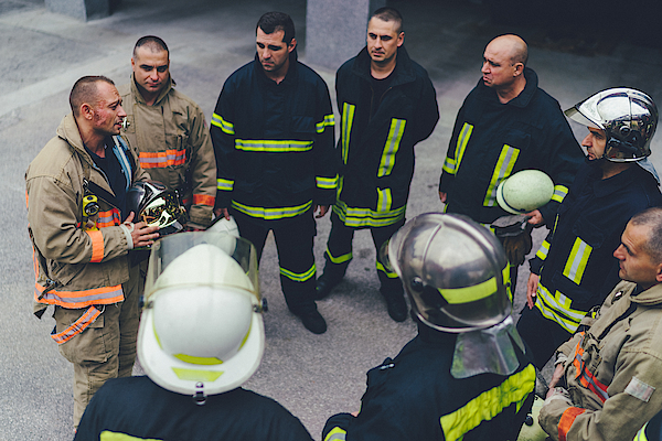 Team Of Firefighters Listening To Instructions Photograph by Martin-dm
