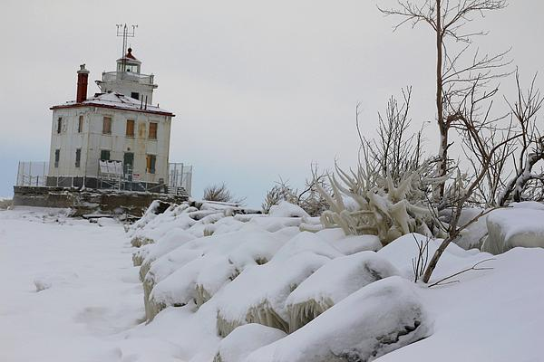 Lighthouse Photograph - The Frozen Sentinel by Frederic Vigne