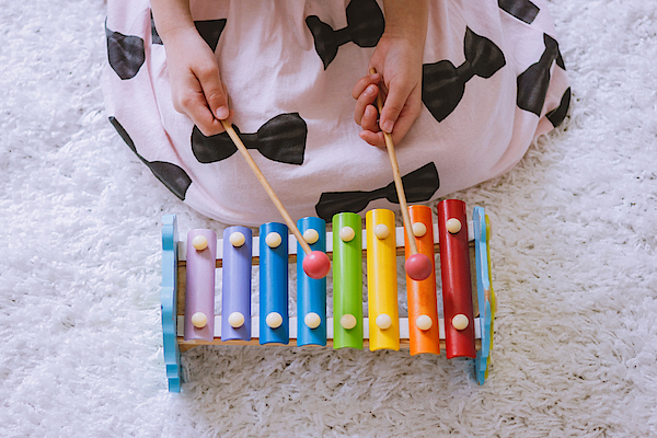 Toddler Playing A Xylophone At Home Photograph by Suphat Bhandharangsri Photography