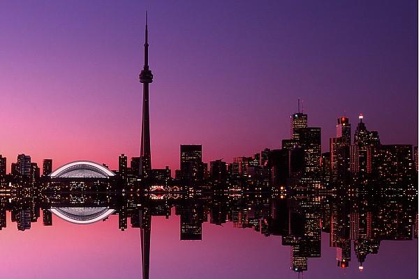 Light Photograph - Toronto Skyline At Sunset, Toronto by Alan Marsh