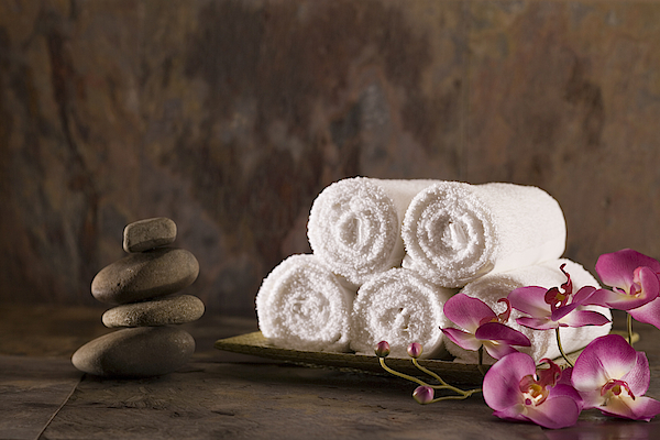 Towels, Flowers, And Stones Photograph by Comstock Images
